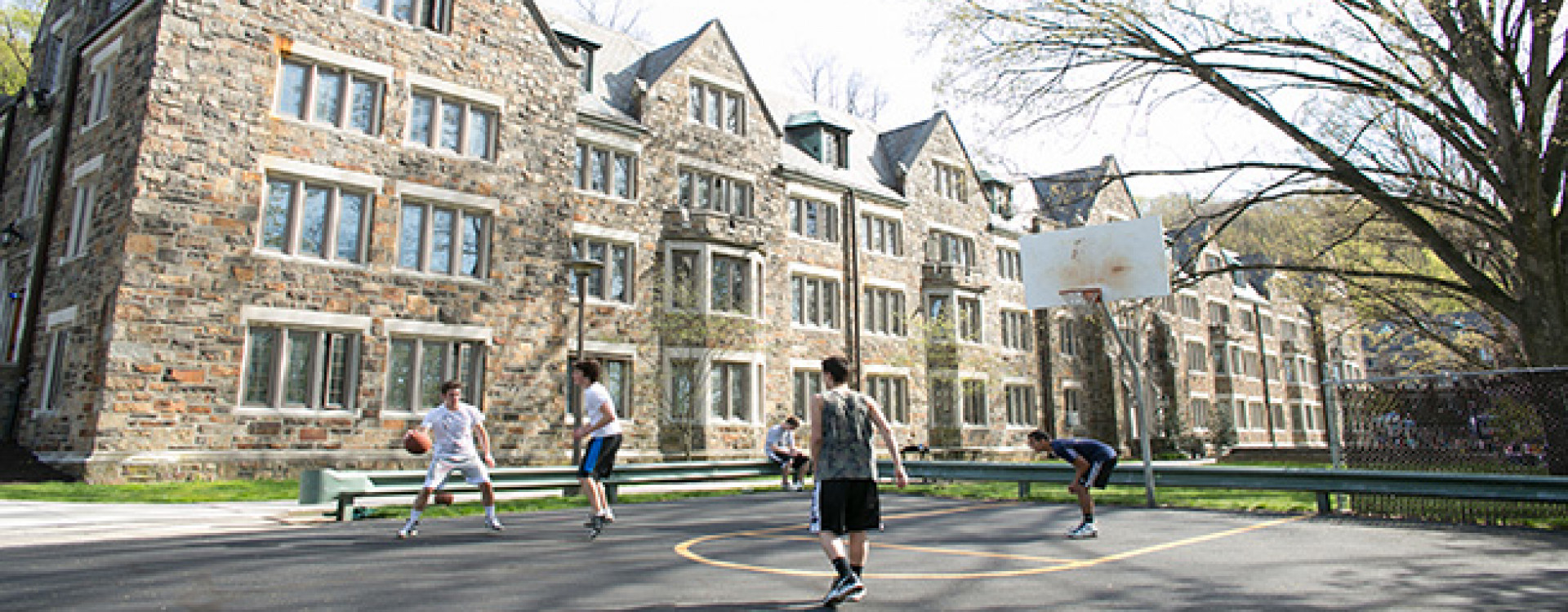 Lehigh Residence Hall and students playing basketball