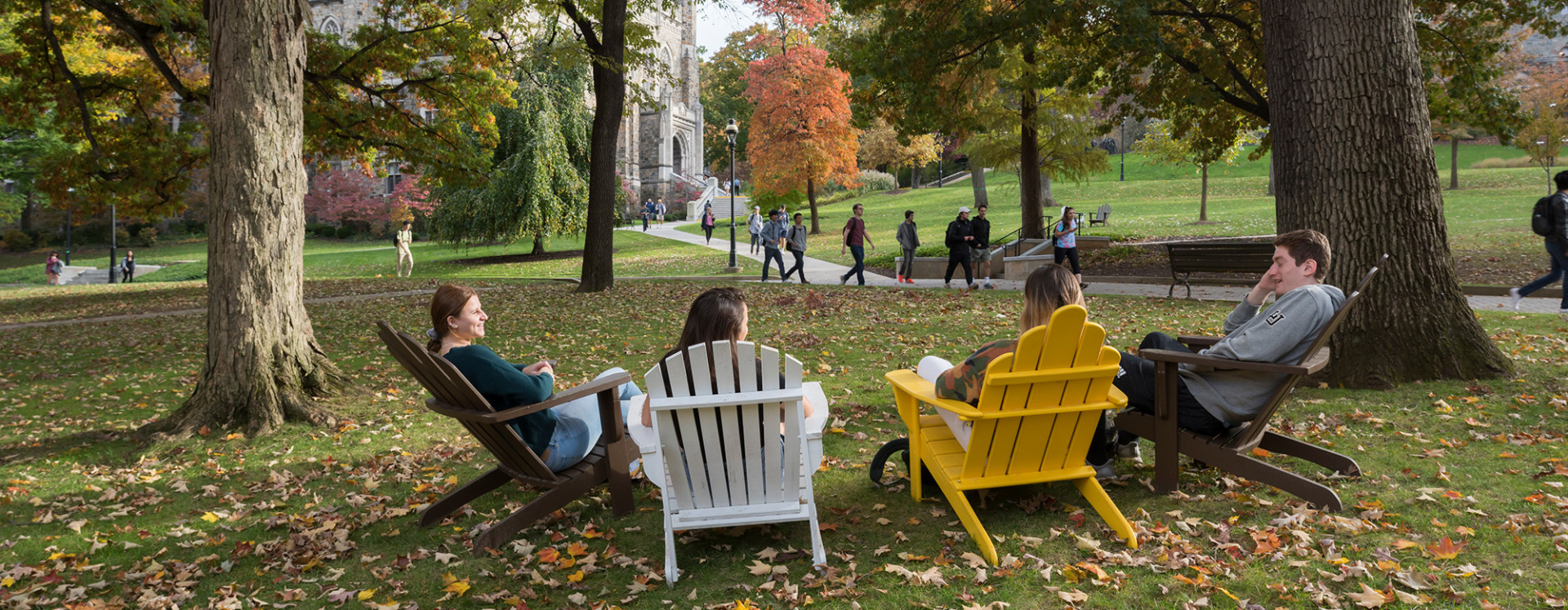 Various students on campus in the fall