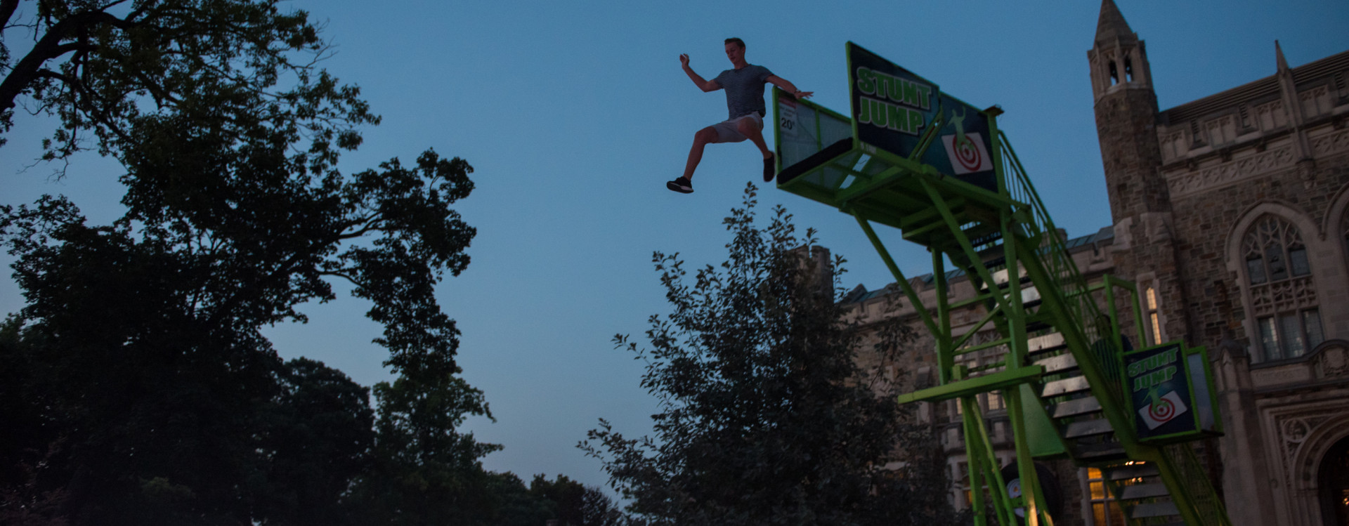"""Student trying out stunt jump at August 2018 """"Nightvision"""" event."""